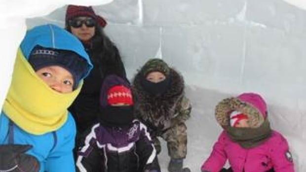 This submitted photo shows daycare children in Nain playing in an igloo.