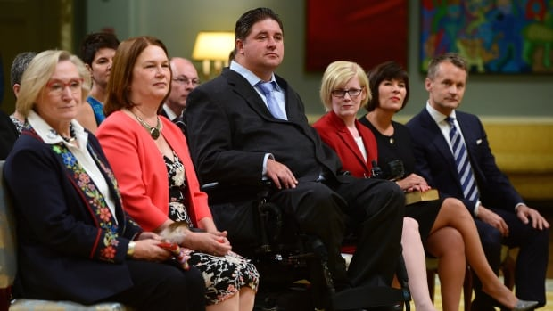 Ministers, left to right, Carolyn Bennett, Jane Philpott, Kent Hehr, Carla Qualtrough, Ginette Petitpas Taylor and Seamus O'Regan attend a swearing-in ceremony at Rideau Hall Monday.