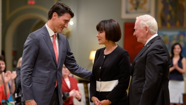 Prime Minister Justin Trudeau congratulates new Health Minister Ginette Petitpas Taylor as Gov.-Gen. David Johnston looks on at a swearing-in ceremony at Rideau Hall in Ottawa on Monday.
