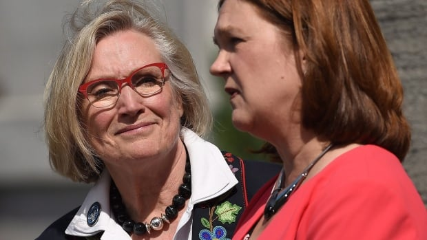 Carolyn Bennett, left, minister of Crown-Indigenous Relations and Northern Affairs looks on as Indigenous Services Minister Jane Philpott speaks to media. Prime Minister Justin Trudeau announced major changes to Indigenous governance Monday.