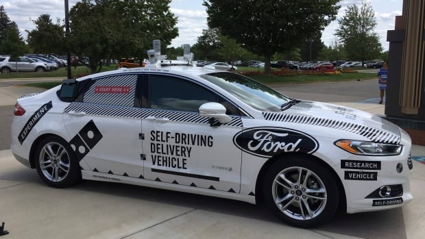 Ford and Domino's are teaming up to test how consumers react if a driverless car delivers their pizzas. The car, which can drive itself but will have a backup driver, lets customers tap in a code and retrieve their pizza from a warming space in the back seat.