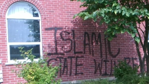 Vandals spray-painted the phrase on the side of Lakeside Church in Guelph.