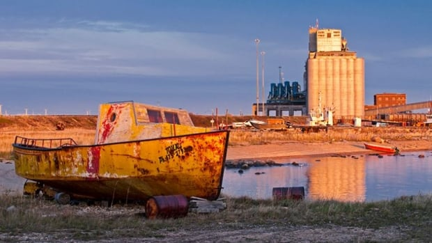 An old boat sits on the shore, Port of Churchill, Manitoba, Canada.