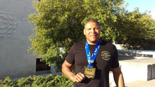 A.J. Scales stands in front of CBC Saskatchewan in Regina holding his gold medal from the 2017 IBJJF World Championships that took place in Las Vegas this past weekend.