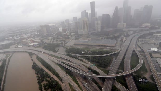 Highways around downtown Houston are empty as floodwaters from tropical storm Harvey overflow from the bayous around the city Tuesday.