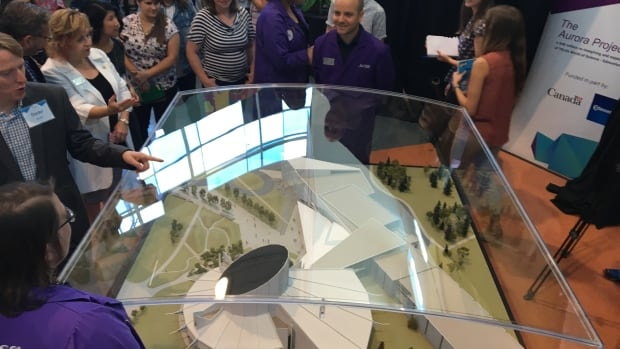 Visitors get a look at the 3D model of the new expansion at the Telus World of Science.