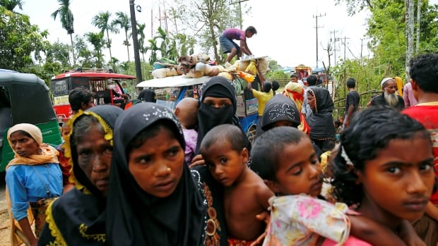 New Rohingya refugees arrive near the Kutupalang makeshift Refugee Camp, in Cox's Bazar, Bangladesh. The International Organization for Migration says up to 18,000 Rohingya refugees have fled Myanmar in the last week.
