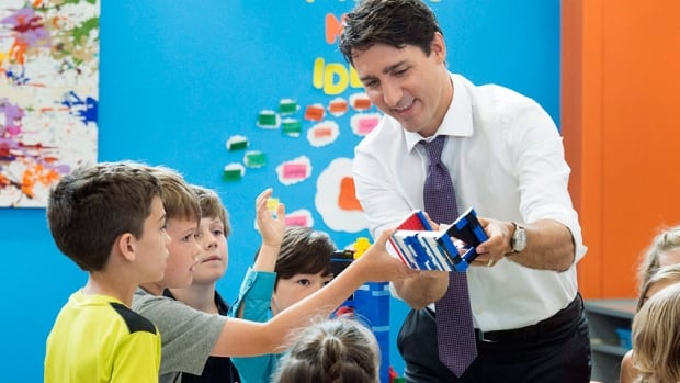 Prime Minister Justin Trudeau worked on a tower with children at the Wee College daycare and early learning centre in Moncton on Wednesday before making the funding announcement.