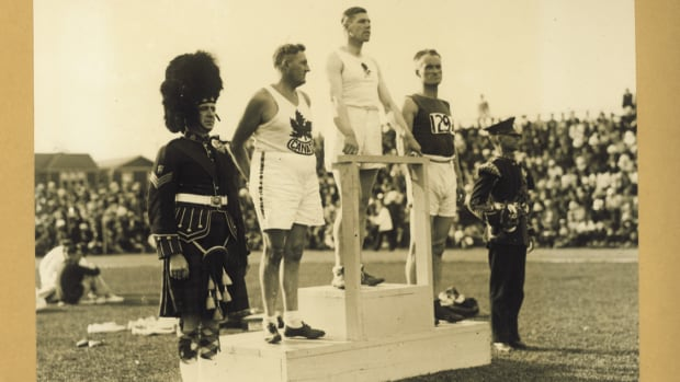 The winners of the hammer throw in 1930 appear on a tiered podium -- the first time that was a feature of international games.