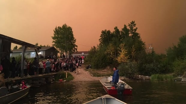 Residents from Wasagamack First Nation were taken by boat to St. Theresa Point to escape nearby wildfires.