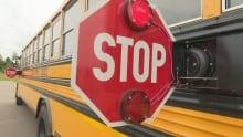 School bus rear-mounted stop signal