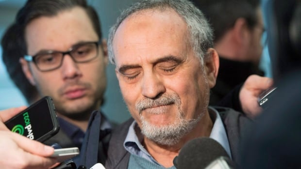 Mohamed Labidi, president of the Quebec Islamic Cultural Centre, pauses as he answers a question from reporters in February after attending a court appearance of Alexandre Bissonnette, charged in the Quebec City mosque shooting. Labidi's car was torched on Aug. 6.