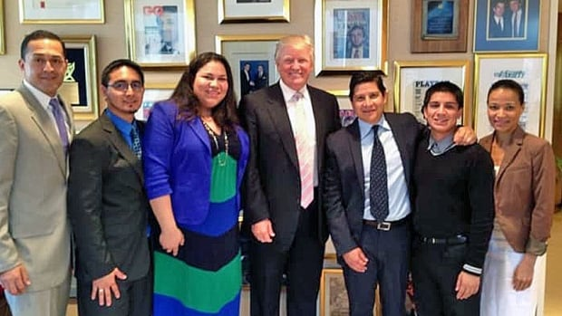 Donald Trump, centre, is flanked by Dreamers in this August 2013 photo snapped at Trump Tower in Manhattan. Estuardo Rodriguez, in the grey suit, stands to the far left. Gaby Pacheco, an immigration rights activist, is left of Trump.