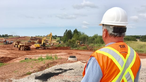 Stephen Yeo, chief engineer for the province's department of transportation, checks on the progress of the Cornwall bypass project at York Point Road in September.