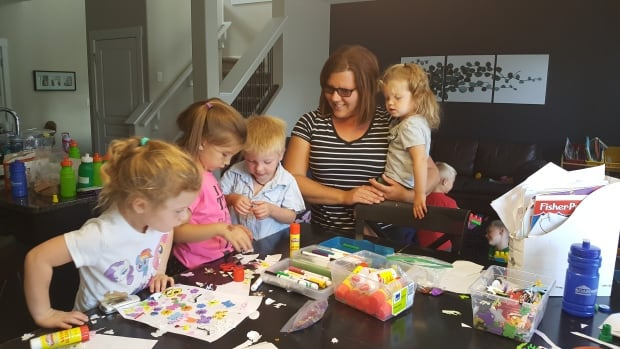 Kim Hengstler runs a busy daycare in Regina's Fairways West neighbourhood. Her home no longer qualifies for bus service to McLurg elementary school, leaving her in a 'complicated bind.'