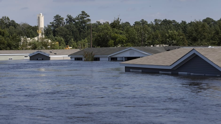 Submerged houses are seen by flood waters from Tropical Storm Harvey in Rose City, Texas.