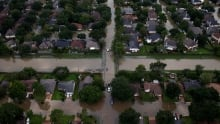 STORM HARVEY houses partially submerged in floodwaters