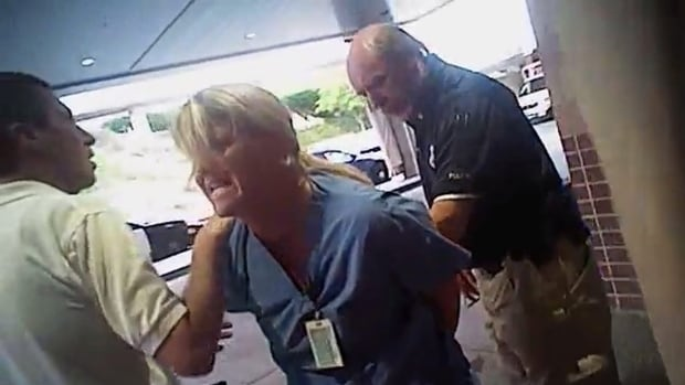 The Salt Lake City police officer seen in this July 26 photo taken from police body camera video has been fired for his actions involving the arrest of a nurse who refused to draw blood from an unconscious patient who had been involved in a car accident.