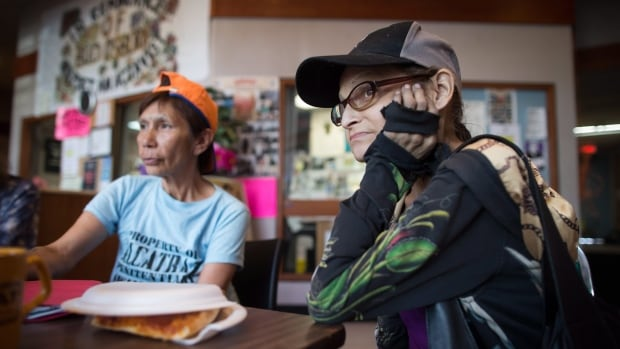 Chereece Keewatin, right, and Irene Mountain listen during a meeting of the B.C. Association of People on Methadone in the Downtown Eastside of Vancouver, B.C.