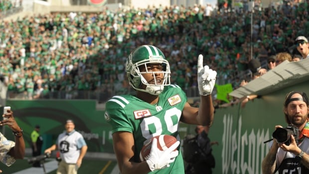 Saskatchewan Roughriders wide receiver Duron Carter celebrates a touchdown by taunting Winnipeg Blue Bombers fans during first-half CFL action in Regina on Sunday.