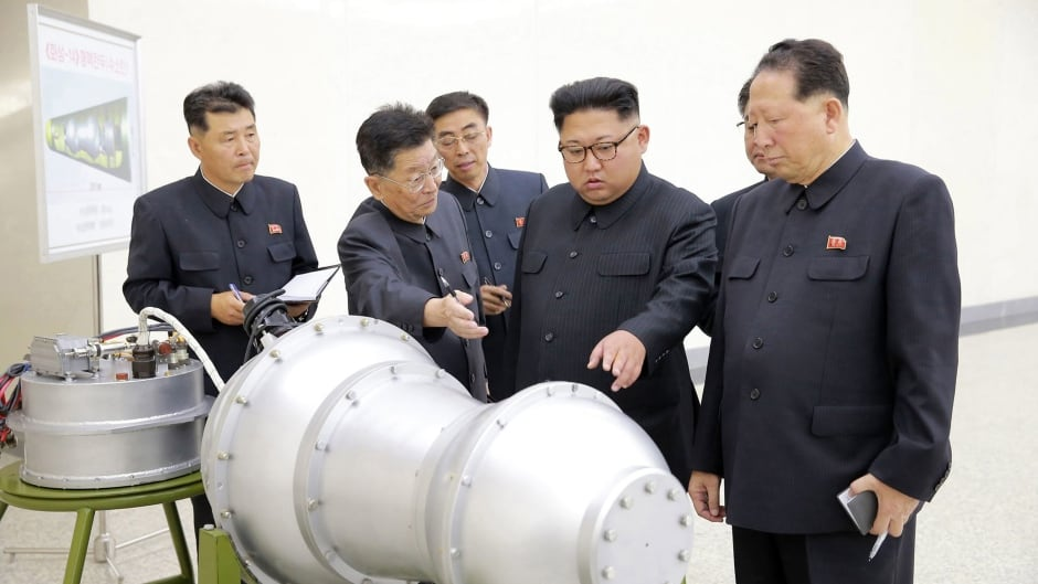 This undated file photo distributed on Sunday, Sept. 3, 2017, by the North Korean government, shows North Korean leader Kim Jong-n, second from right, at an undisclosed location in North Korea.
