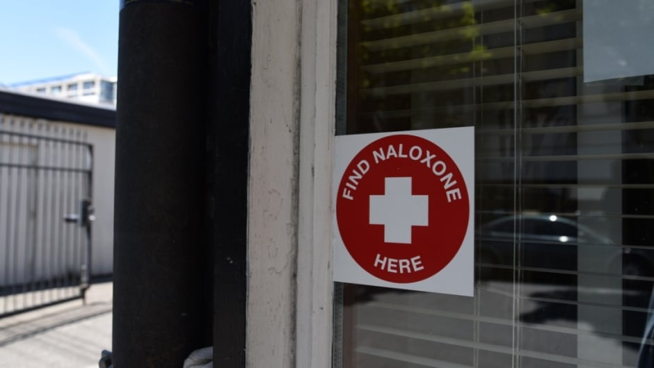 A sticker on the window of STS Pharmacy in downtown Victoria. Naloxone is a drug that can counteract an opioid overdose.