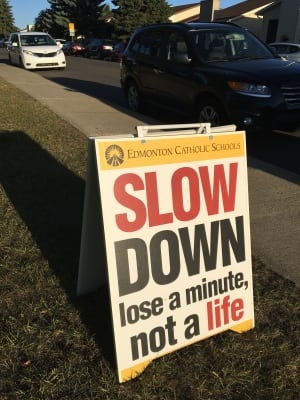 A sign outside St. Kateri Catholic School warns drivers about their speed