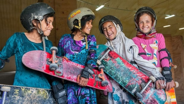 In the 'Skate Girls of Kabul' installation — now on display at the Aga Khan Museum in North York — photographs show triumphant young girls gliding down ramps together and standing proudly with their skateboards in hand at a skate park in Kabul, Afghanistan.