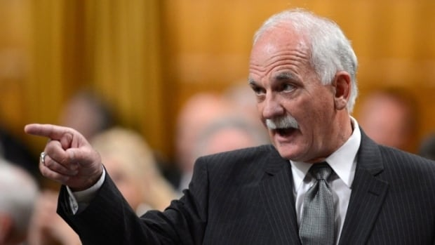 A review of Justice Vic Toews conduct by Canada's judicial watchdog won't proceed until after a federal court ruling.