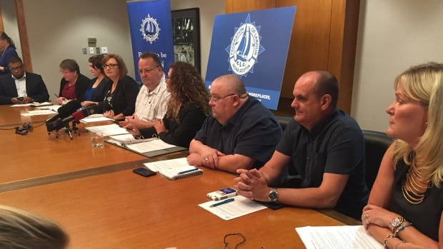 Representatives of seven unions speak with media on Wednesday, Sept. 9.