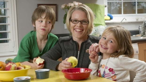 Nutrition researcher Jess Haines, seen with her two children, says it's OK to pack snacks in school lunches so long as they're healthy snacks. Focus on fruits, vegetables and whole grains.