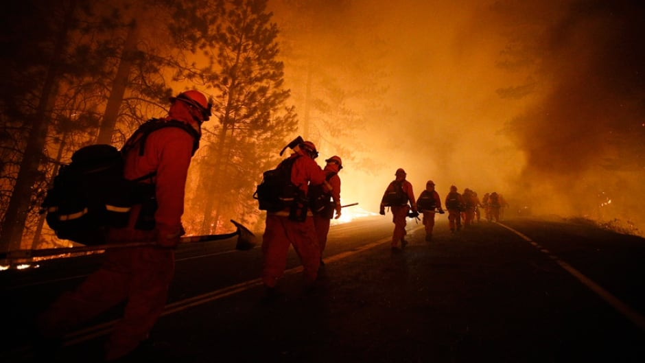 From Aug. 25, 2013, file photo, firefighters continue to battle the Rim Fire near Yosemite National Park, California.