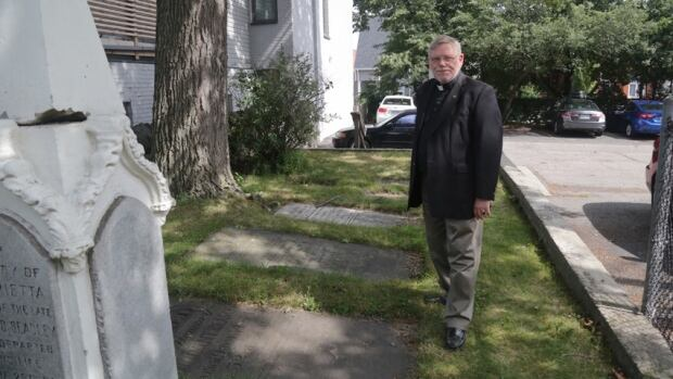 Rev. Peter Wall, dean of the Niagara Anglican Diocese, says this Loyalist memorial near the parking lot is likely stones from the long since closed and paved over cemetery.