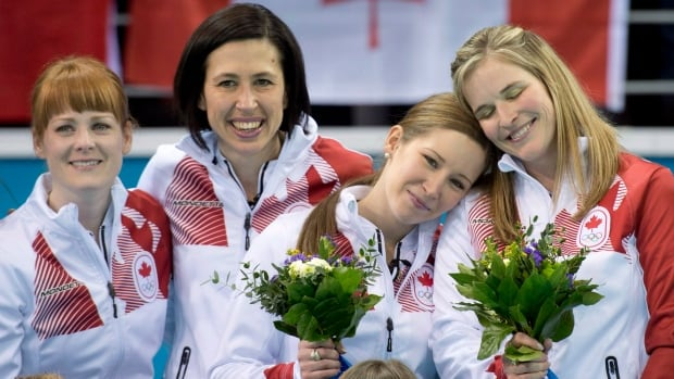 Jennifer Jones, right, along with Jill Officer, Dawn McEwen and Kaitlyn Lawes, won gold in women's curling at the Sochi Olympics in 2014.