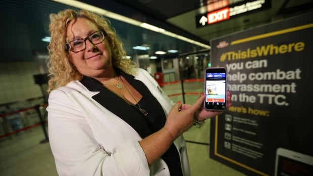 Susan Sperling, the TTC's manager of corporate communications, demonstrates SafeTTC — a new app that allows customers and staff to call for help.