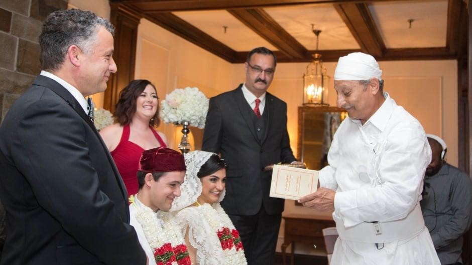 Jal Panthaky presides over an interfaith Zoroastrian wedding ceremony.
