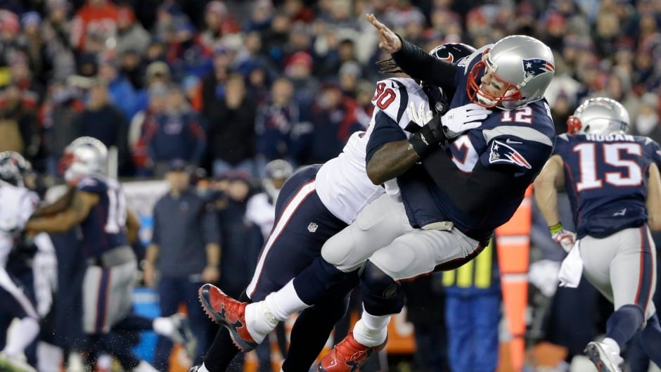 Houston Texans defensive end Jadeveon Clowney levels New England Patriots quarterback Tom Brady after Brady released a pass during the first half of an NFL divisional playoff football game.
