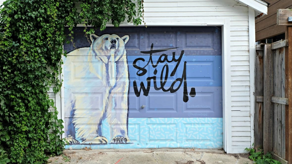 This artist transformed her back lane into an Arctic animal art ...