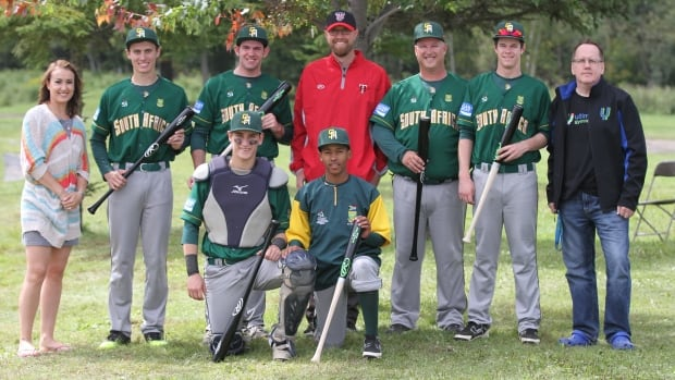 Ultimate Gymnastics head coach Cheronne Viljoen, left, Border Cats GM Dan Grant, centre, and Ultimate Gymnastics owner Greg Balec, right, with coaches and players from South Africa's Under-18 Baseball World Cup team.