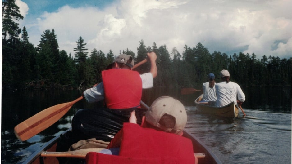 The Anderson family on a canoeing adventure in calmer waters.
