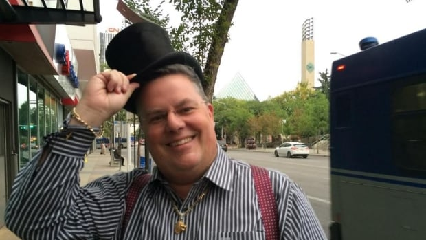 Clinton Beck, the owner of Beck Antiques & Jewellery in Edmonton, poses with the historic top hat.