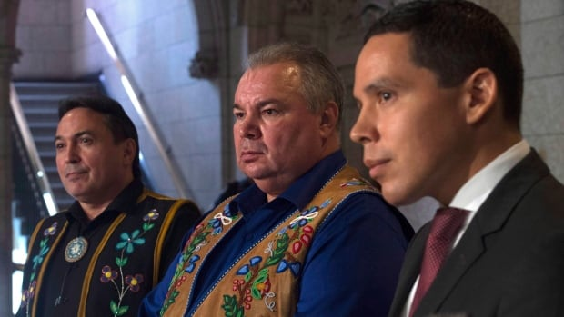 President of the Inuit Tapiriit Kanatami Natan Obed, right, appears with AFN National Chief Perry Bellegarde, left, and Manitoba Metis Federation President David Chartrand to speak to reporters in the foyer of the House of Commons on Parliament Hill last December.