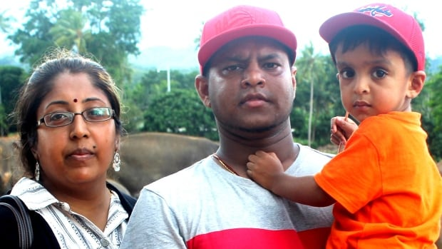 Shanty Thivakaran, husband Thiva Maheswaran and their son Athiran on vacation in Sri Lanka. The family had to repurchase plane tickets after they weren't allowed on their original Air Canada flight.