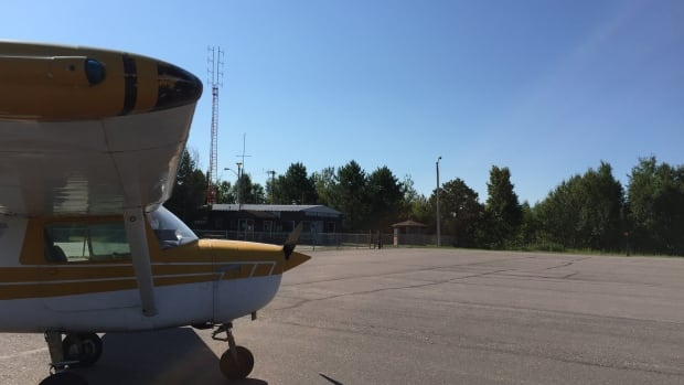 Jeff Walters' plane in front of the terminal building at the Atikokan Municipal Airport.