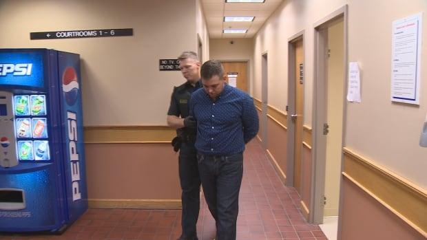 Craig Pope walking to court