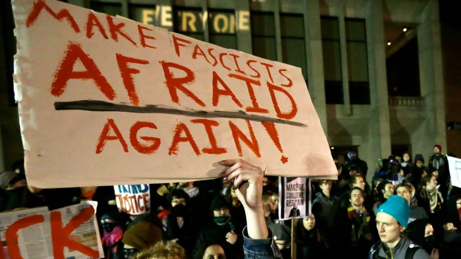 """A protester holds a sign that reads """"Make Fascists Afraid Again!"""" during a demonstration on Jan. 20, 2017 at the University of Washington campus, where far-right commentator Milo Yiannopoulos was giving a speech."""