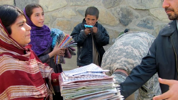 Kushi and her sister made a living selling cheap scarves outside NATO's Kabul headquarters.