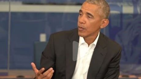 ​Obama surprises students with visit to D.C. school