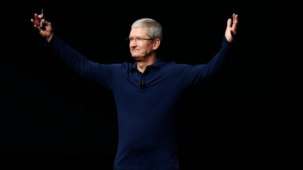 Apple CEO Tim Cook unveils the iPhone 7 last year. Its successor comes out Tuesday.