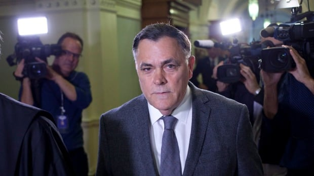 Former Liberal MLA Darryl Plecas is escorted from legislative assembly after being elected Speaker on Friday. On Saturday, he had his BC Liberal Party membership revoked.